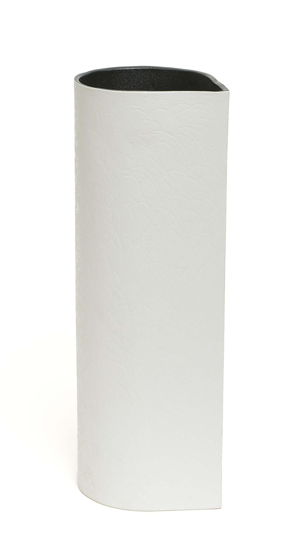 Tall thin porcelain vase, white on the outside and black on the inside in t