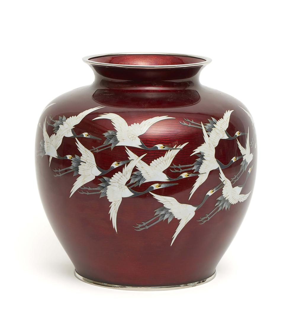 Globular cloisonné vase with a design of flying cranes on a red ground. Sho