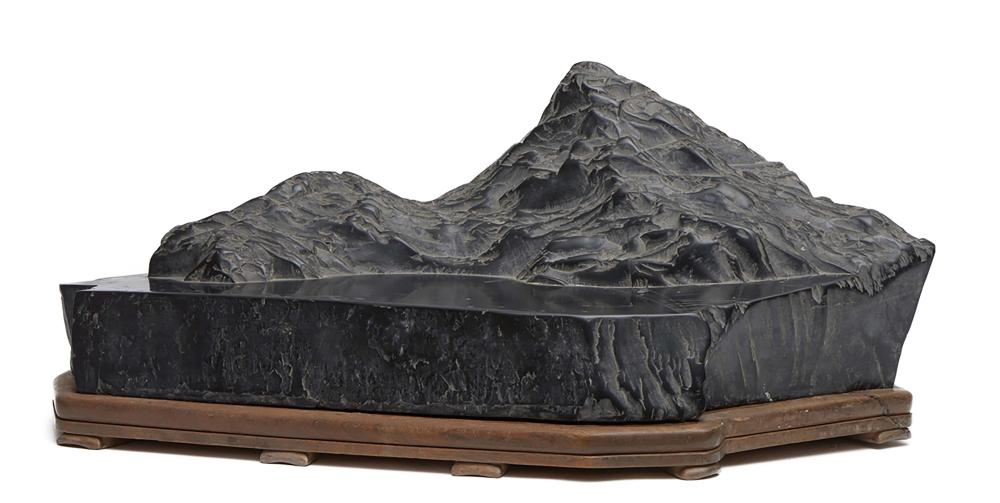 Large exceptional black suiseki-stone on a wooden stand depicting mountains