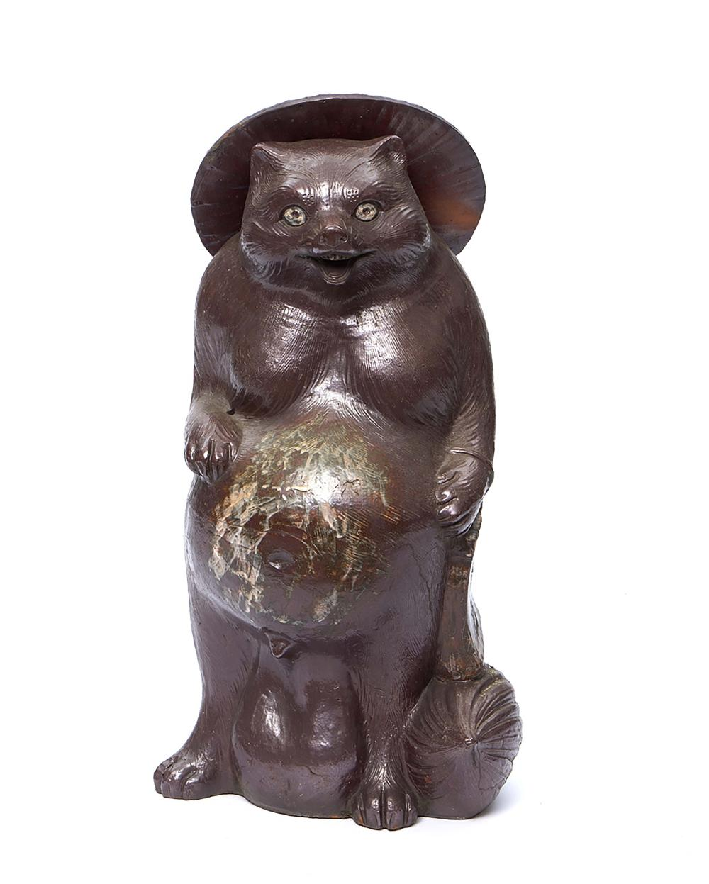 Large and heavy brown glazed stoneware Tanuki-badger with a potbelly and a