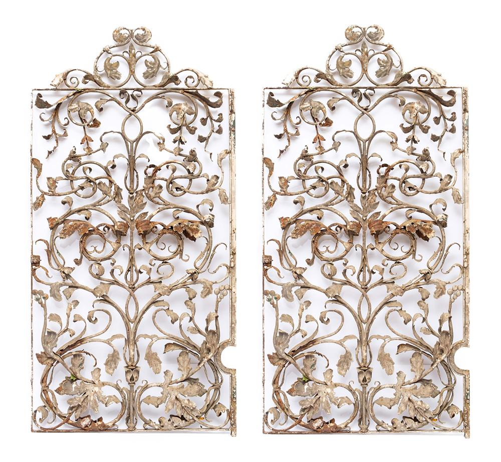 Set of two heavy wrought-iron gates, symmetrically decorated with acanthus