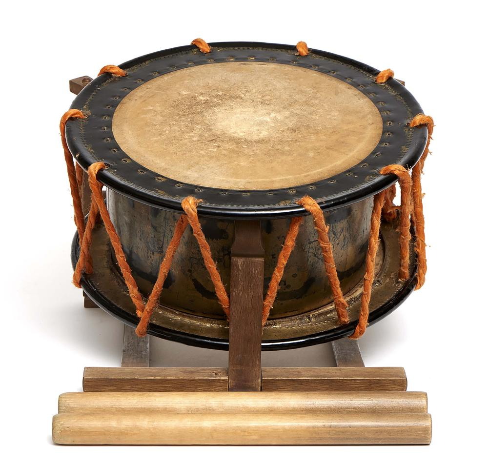 Japanese flat and round drum (shime-daiko), with orange cords on a stand to