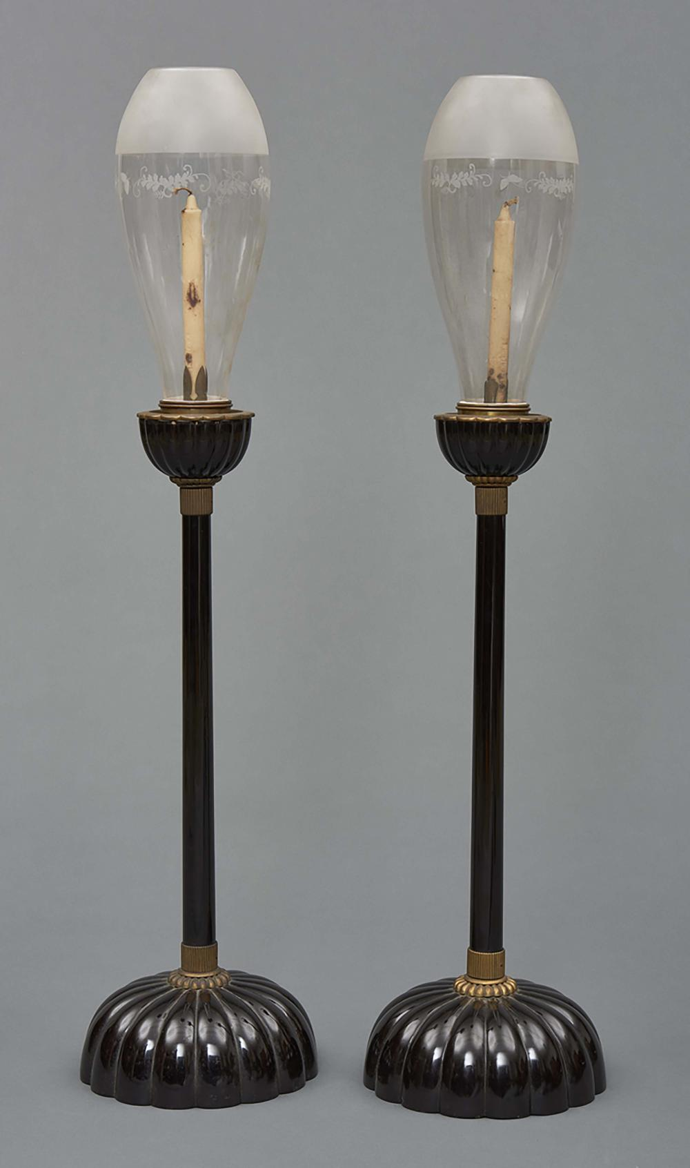 Set of two large black lacquered wooden temple lamps for a candle with glas