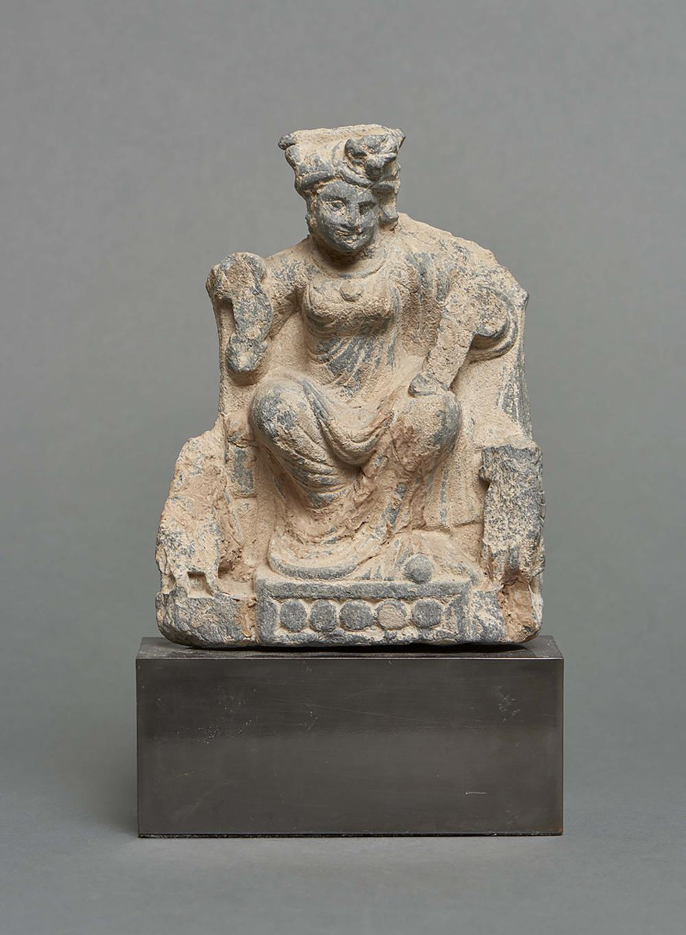 Schist Gandhara figure depicting the Indian goddess of children and smallpo