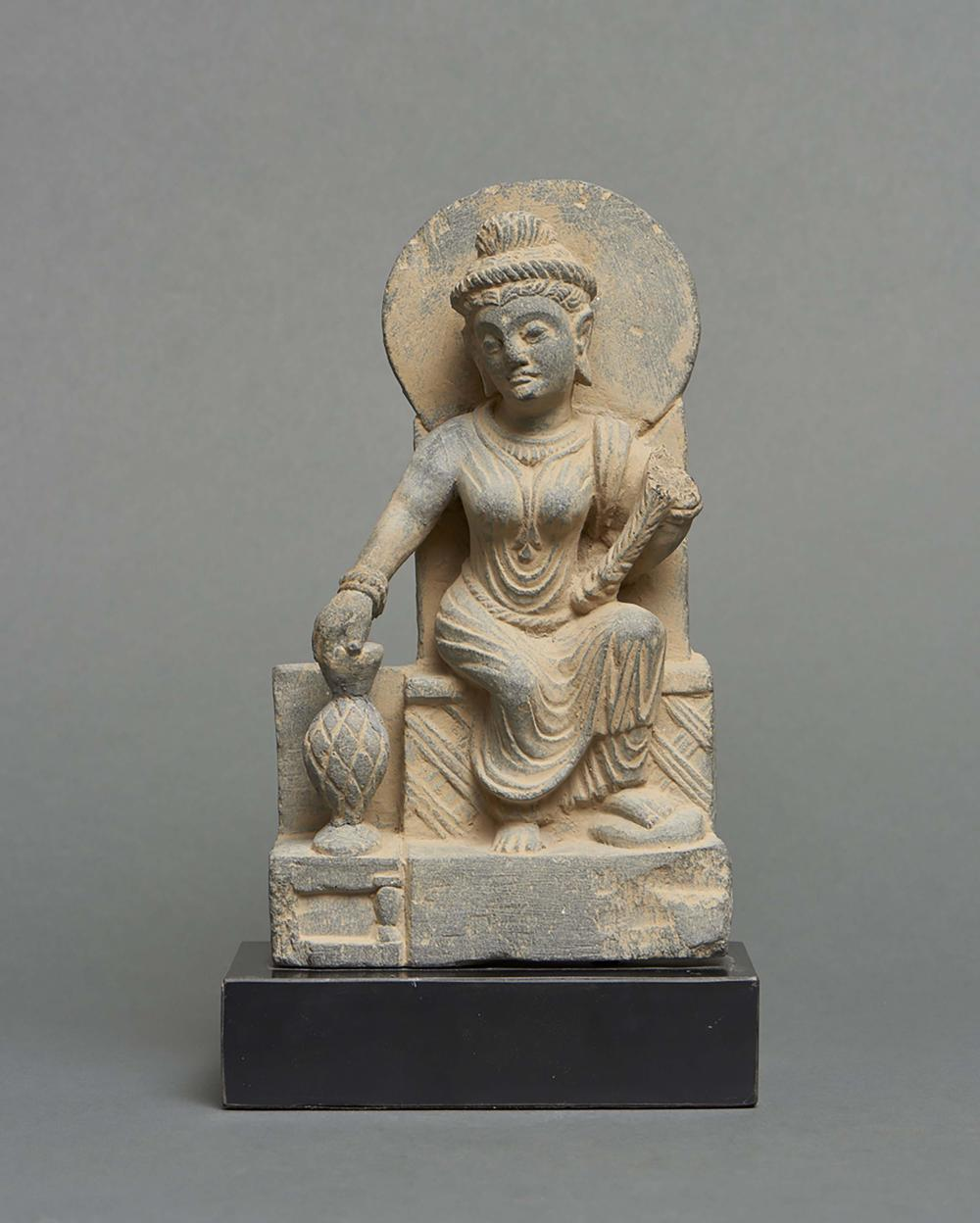 Schist Gandhara figure depicting the Indian goddess Hariti, who is the prot