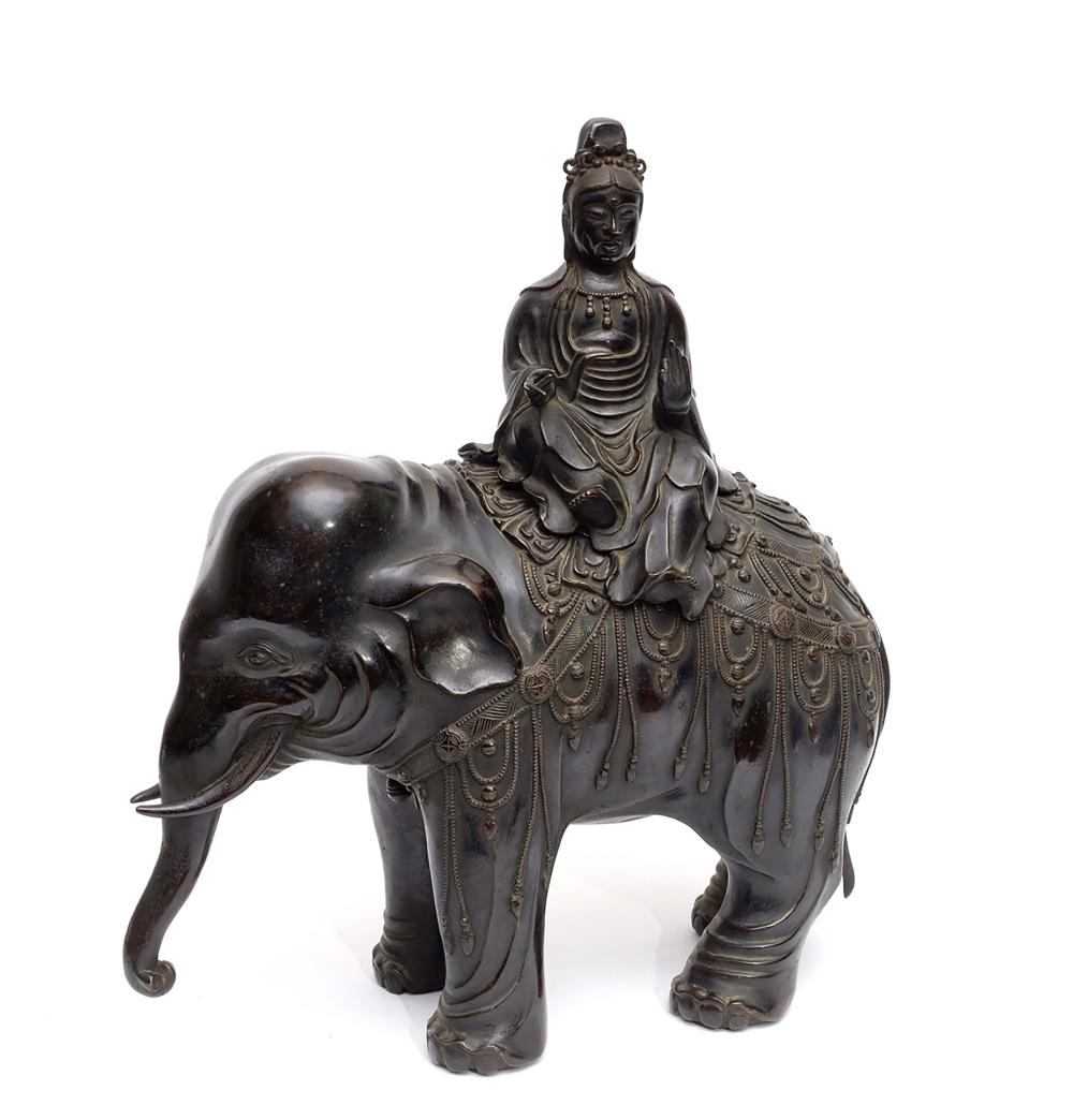 A black patinated brons figure of bodhisattva Kannon sitting astride on her