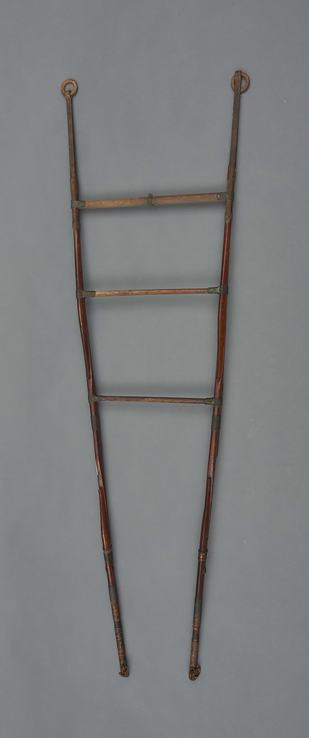 Rare wood and metal rack resembling a ladder and used to hang various artef