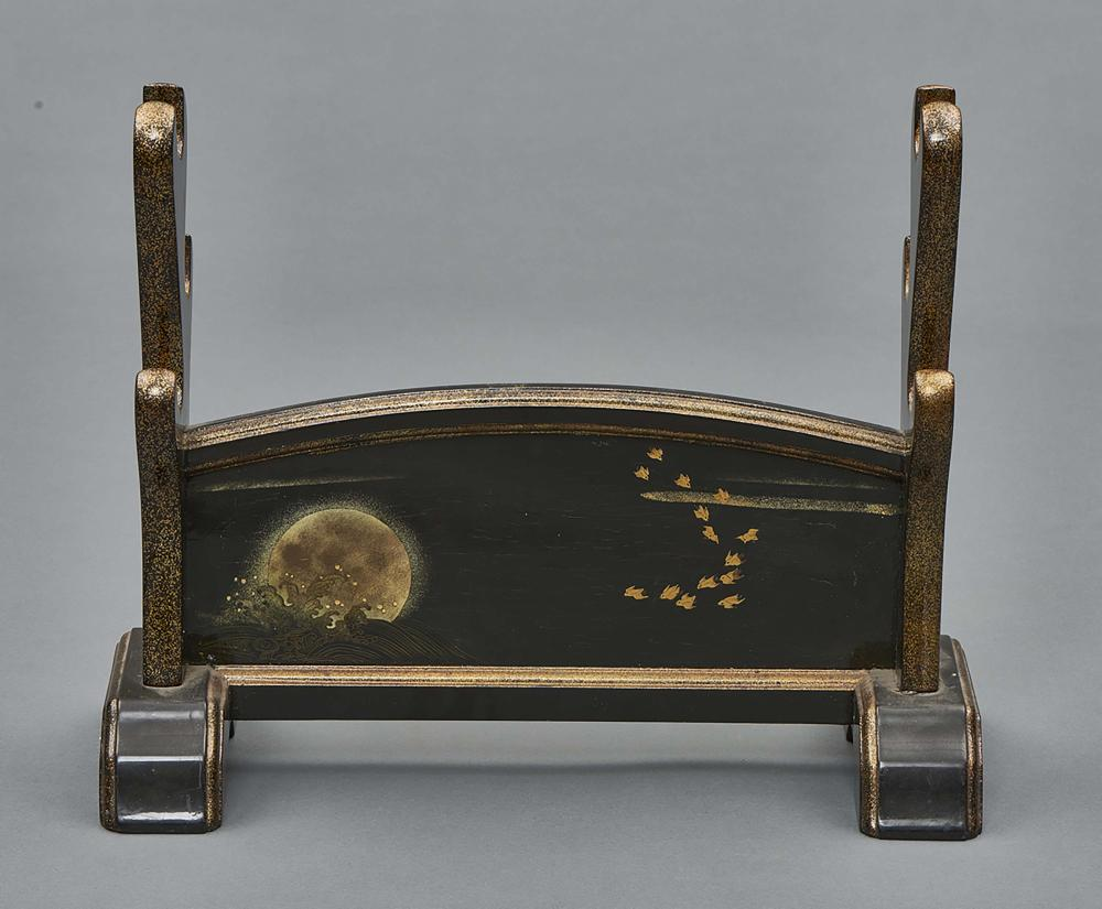 Black lacquered stand for three swords, the rims decorated with sprinkled g