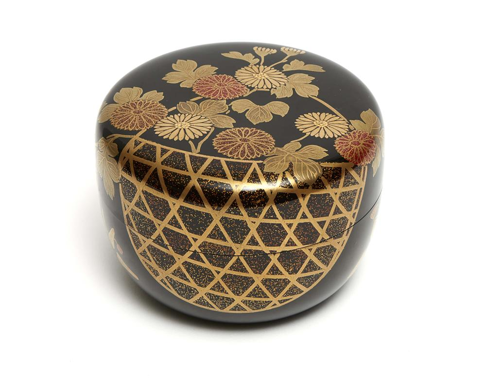 Broad black lacquered teacaddy (natsume) decorated with a flower basket wit