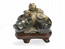 A BOY RIDING A BUFFALO IN CARVED JADE