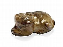 A FELINE IN CARVED JADE China, Qing dynasty, 19th century