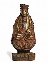 A FIGURE OF GUANYIN SEATED ON A DOUBLE LOTUS THRONE