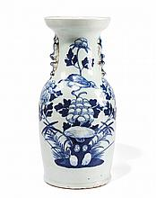 A LARGE VASE WITH CÉLADON GLAZE, PAINTED IN BLUE AND WHITE China, Qing dynasty, 19th century