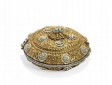 A CIRCULAR CASE IN GILT AND SILVERED COPPER Tibet, 19th-20th century