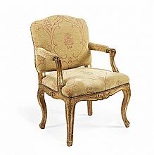 A CARVED AND GILT WALNUT ARMCHAIR Piedmont, mid-18th Century