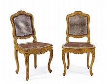 A PAIR OF OCHRE CANED CHAIRS First half of 18th Century