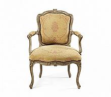 A GREY PAINTED AND CARVED WOOD ARMCHAIR France, mid-18th Century