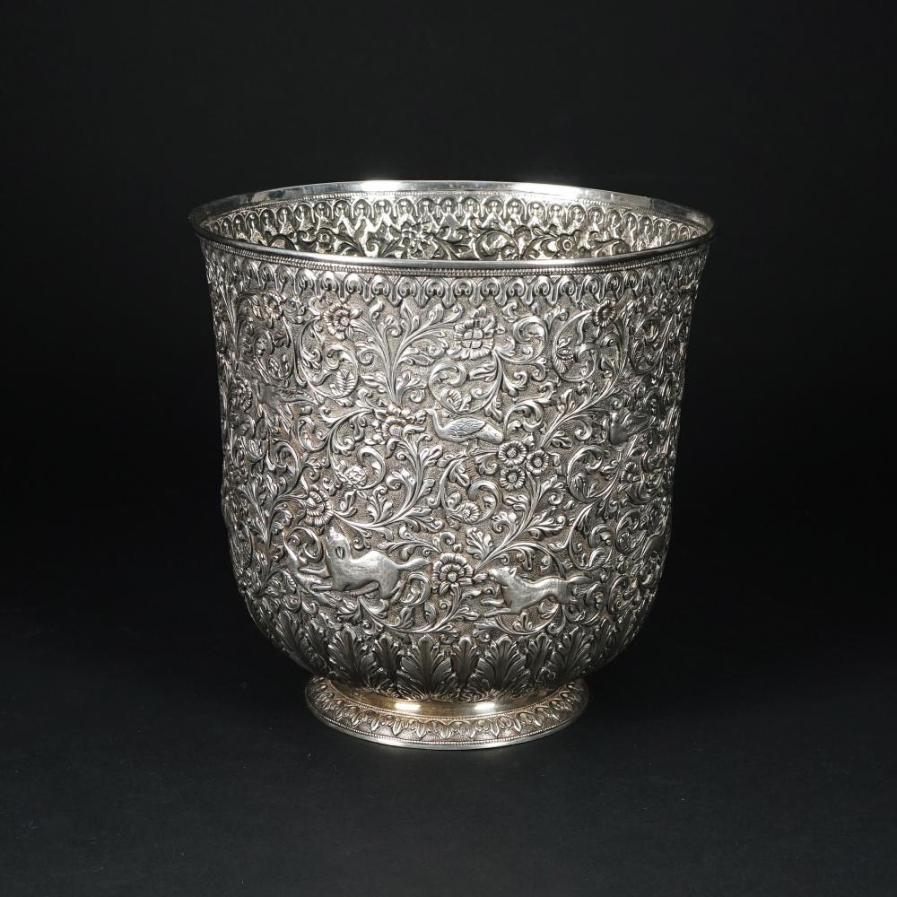 An embossed silver vase, possibly India, 19th century, O.M.