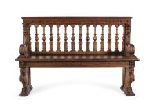 An antique walnut carved bench