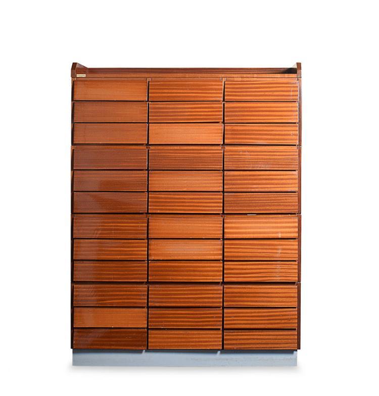 A mahogany venereed chest of drawers with 36 drawers on three columns, Schirolli, Mantova, '50s