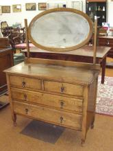 Medium oak dressing table with bevel plate, two short drawers over two long drawers
