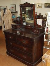Stained oak dressing table bevel mirror, two short drawers over two long drawers, on original pot castors