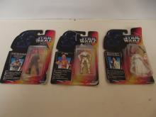 Three Star Wars figures, Luke Skywalker, C3PO and Princess Leia