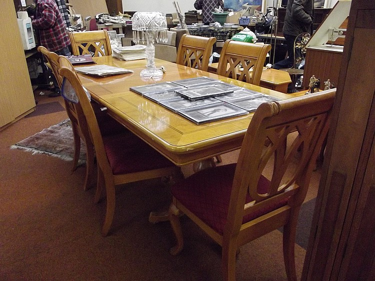 light wood extending dining table and six chairs
