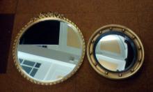 Two gilt framed circular wall mirrors