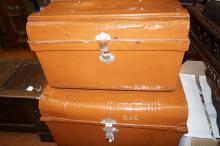 Two graduating tin trunks