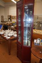 Illuminating rosewood corner cabinet