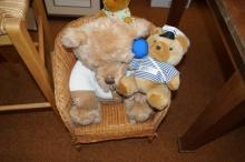 Small wicker chair with soft toys