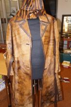 Hide jacket with matching hat, mannequin not included