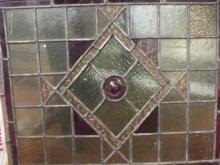 Three leaded and stained glass windows