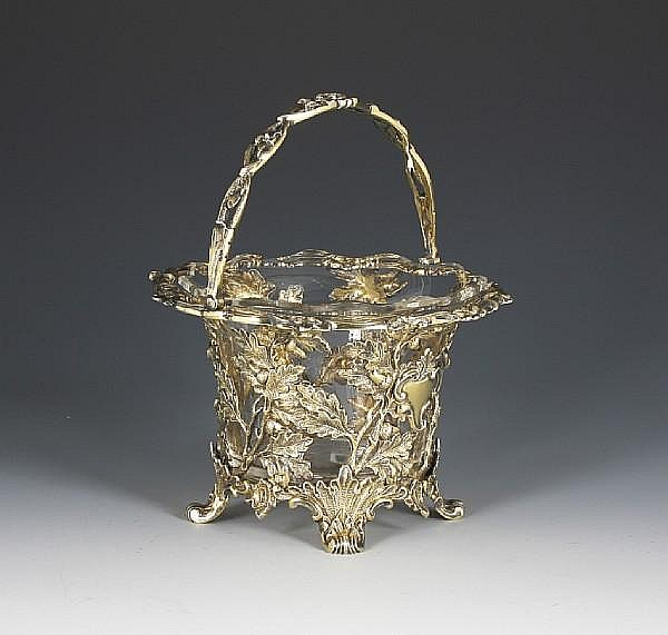 A Victorian silver gilt swing handled sugar basket By George John Richards, London, 1855,