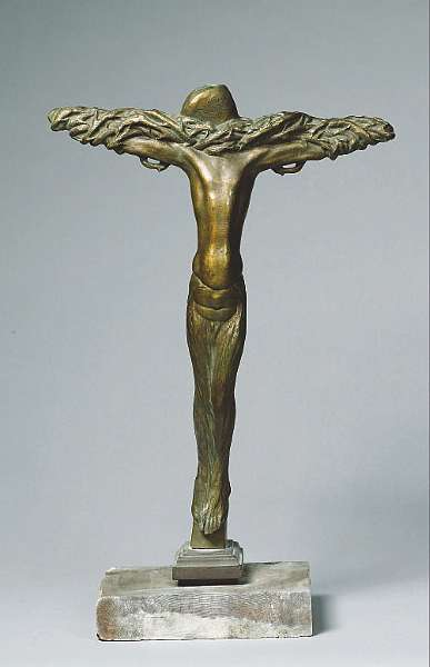 Charles Sykes (British, 1875-1950): A bronze figure of Christ on the cross