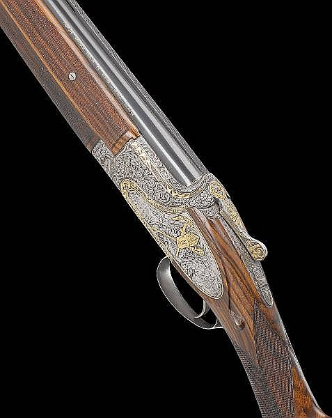 A fine commemorative Ernst-engraved 12-bore (2¾in) single-trigger over-and-under sidelock ejector gun by F.N., no. 7271257