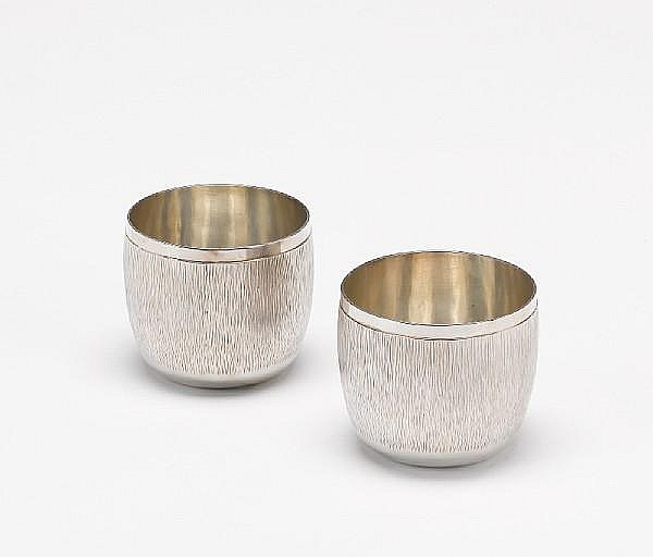 GERALD BENNEY: A pair of silver tumbler cups, London 1983, also impressed GERALD BENNEY LONDON,