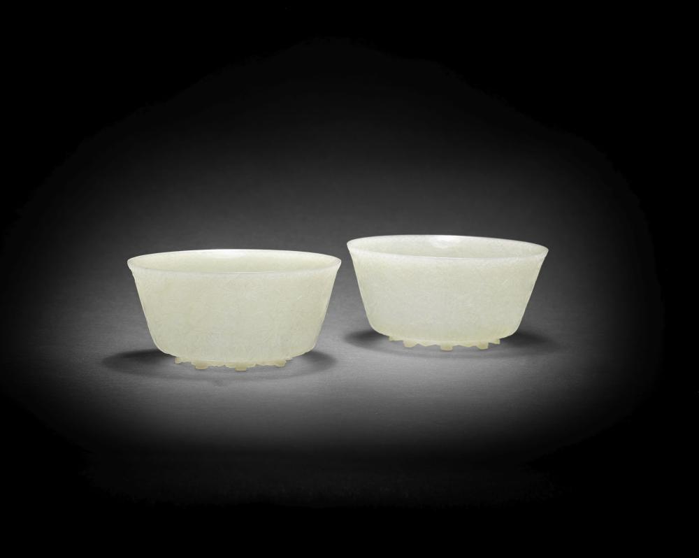 A FINE PAIR OF MUGHAL PALE GREEN JADE BOWLS India 18th/early 19th century (2)