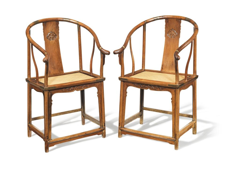 A PAIR OF RARE HUANGHUALI HORSESHOE-BACK ARMCHAIRS, QUANYI 17th century (2)