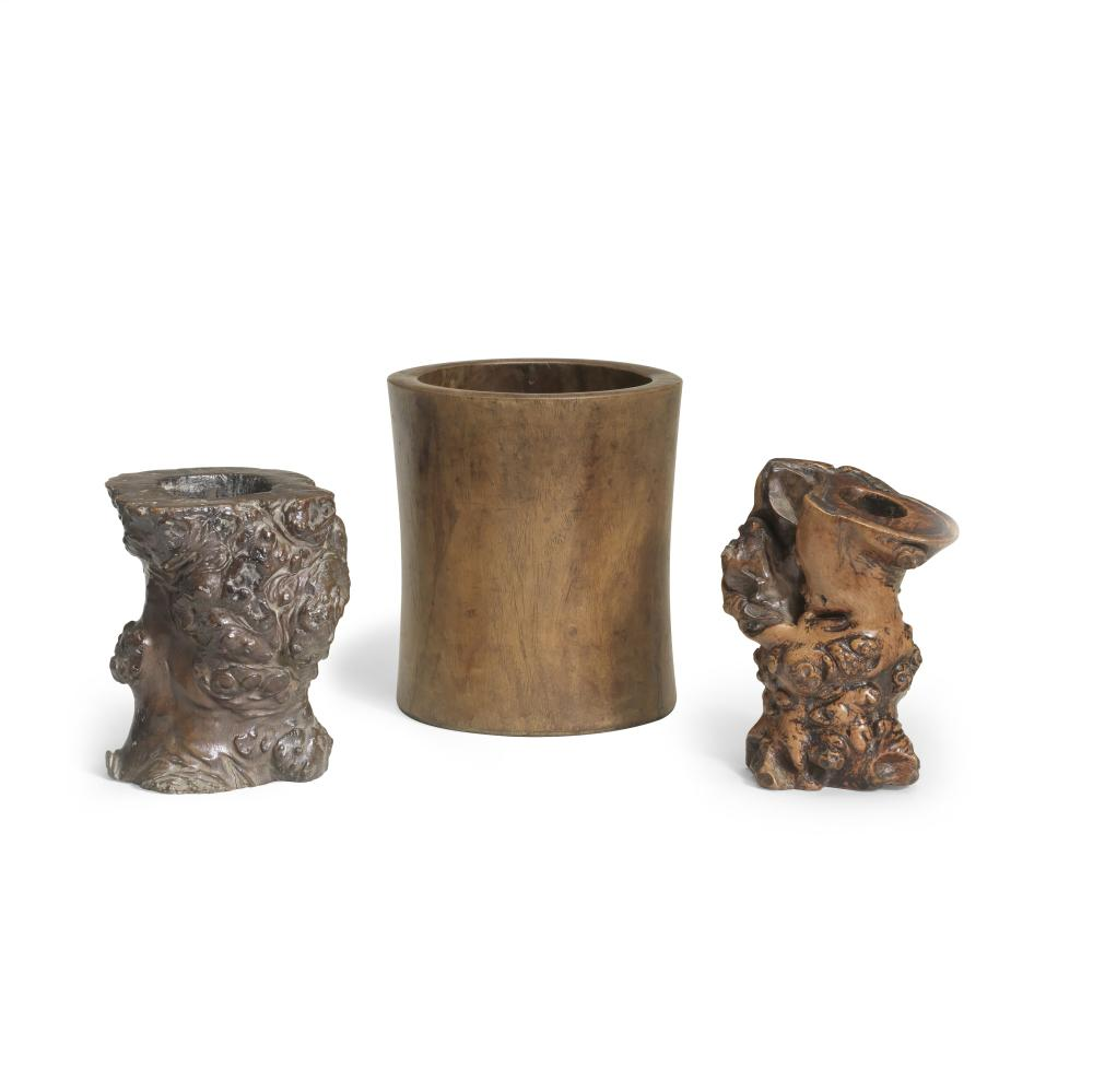 A HUANGHUALI BRUSHPOT AND TWO GNARLED ROOT WOOD BRUSHPOTS, BITONG 18th/19th century (3)