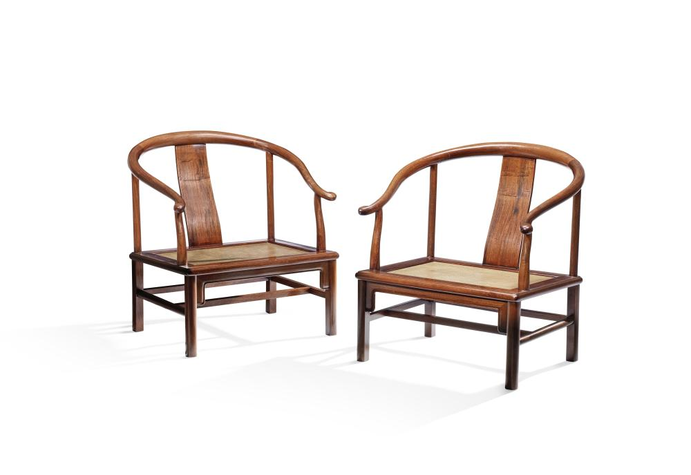 A PAIR OF HUANGHUALI HORSESHOE-BACK LOW ARMCHAIRS (2)