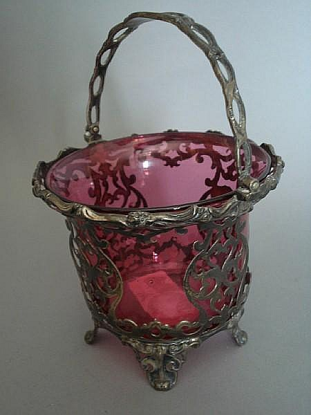 A Victorian silver and cranberry-glass swing handle preserve basket by George Richards, London 1855