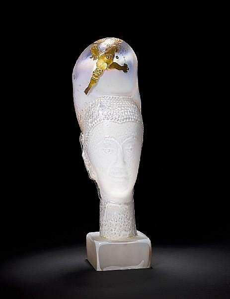 Erwin Eisch (German, born 1927) An opalescent white glass Buddha head, circa 1985