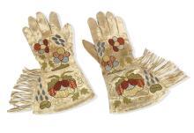 Attributed to Phoebe Anna Traquair HRSA (1852-1936) each glove 33 x 18 cm. (13 x 7 1/16 in.)