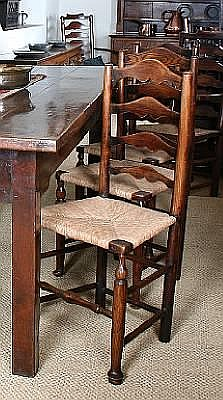A harlequin set of six George IV ash ladder back dining chairs, circa 1820