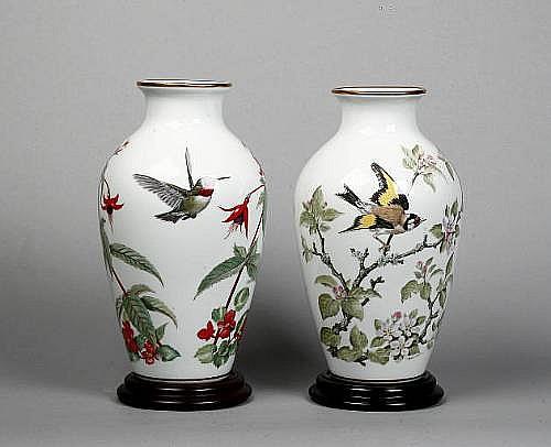 A pair of Franklin Mint Woodland Bird vases