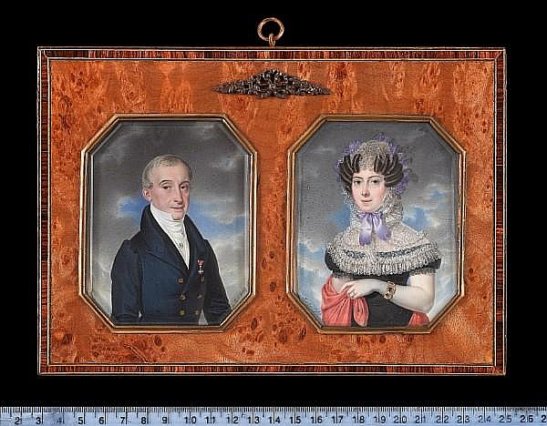 Adalbert Suchy (Austrian, 1783-1849) A pair of portraits of a Nobleman and a Lady: he, wearing blue overcoat with gold buttons, black coat, white waistcoat and stock held with jewelled stickpin, the badge of the Imperial Austrian Order of Leopold on