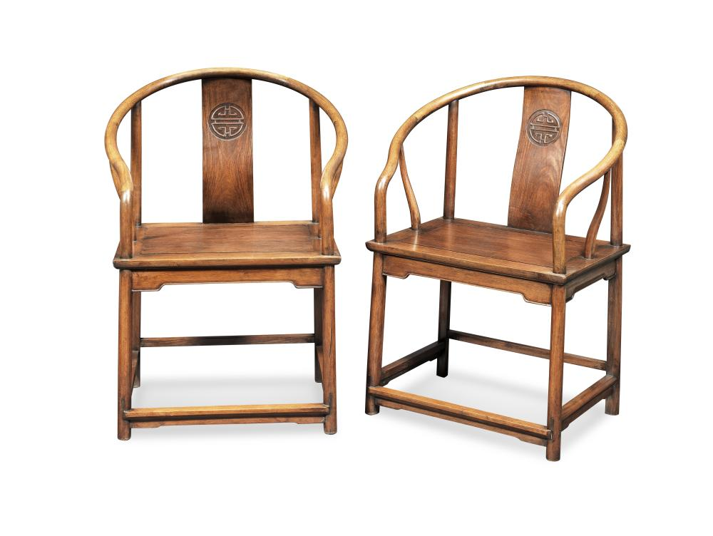 A PAIR OF HONGMU AND HUANGHUALI HORSESHOE-BACK ARMCHAIRS, QUANYI Late 19th/early 20th century (2)