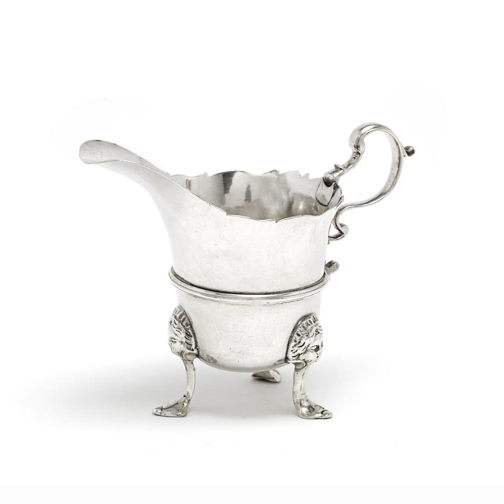 An 18th century Irish provincial silver cream jug Stephen Mackrill, Cork, circa 1759, stamped with maker's mark SM over another punch and stamped STERLING